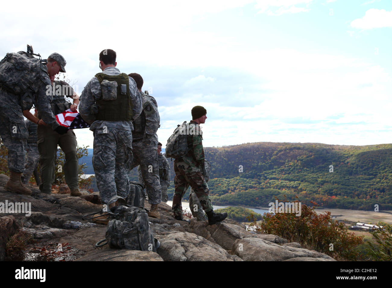 Soldiers folding up an American flag at the top of Anthony's Nose, Cortlandt, NY, USA - Stock Image