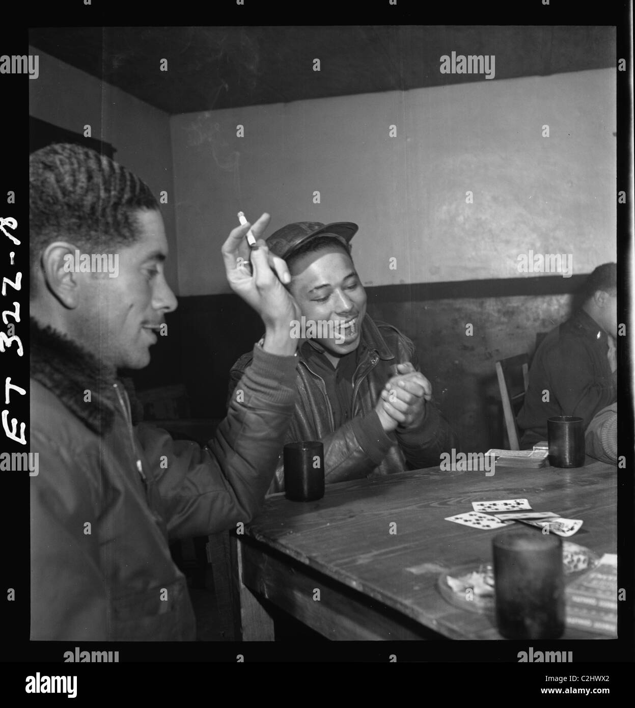 Tuskegee airmen playing cards in the officers' club in the evening - Stock Image