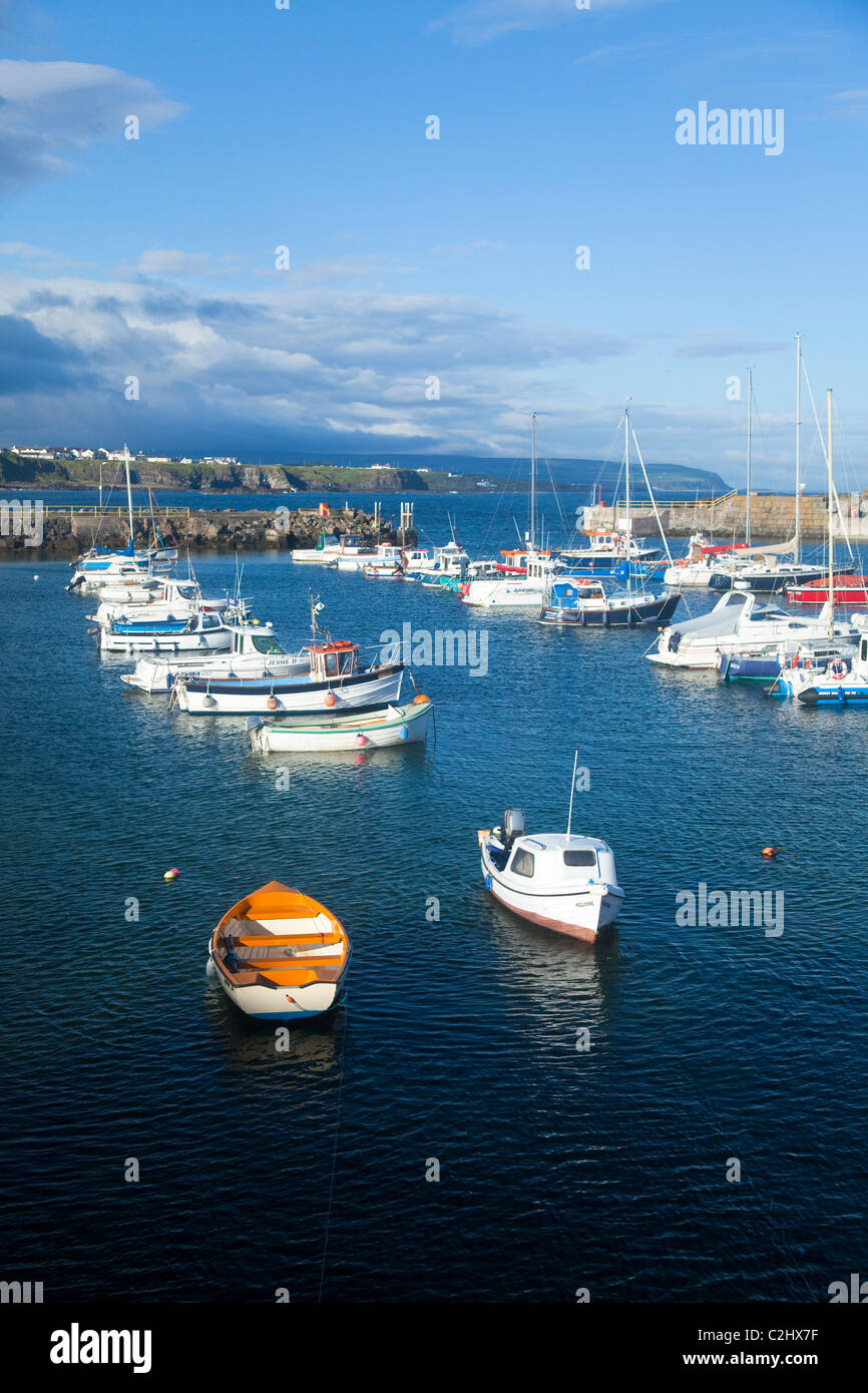 Yachts and fishing boats moored in Portrush Harbour, County Antrim, Northern Ireland. - Stock Image