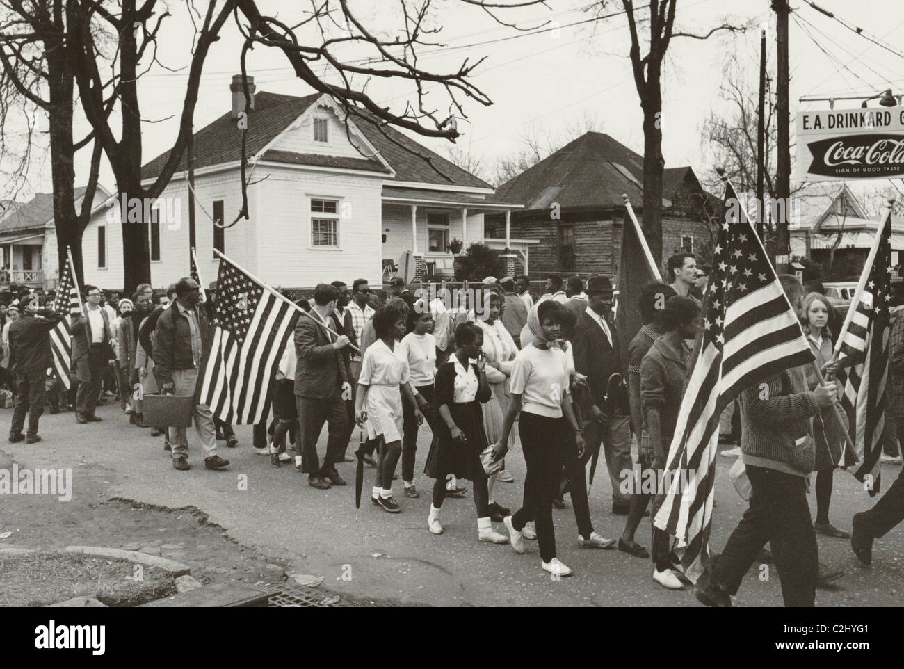 Participants, some carrying American flags, marching in the civil rights march from Selma to Montgomery, Alabama - Stock Image