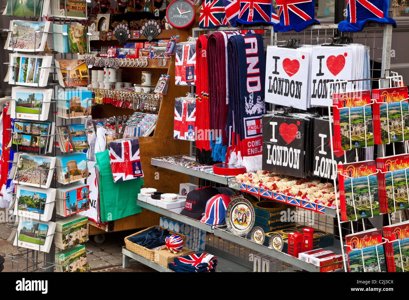 Display of souvenirs,memorabilia and gifts of England and London on a stall in Windsor, Berkshire, England, UK - Stock Image