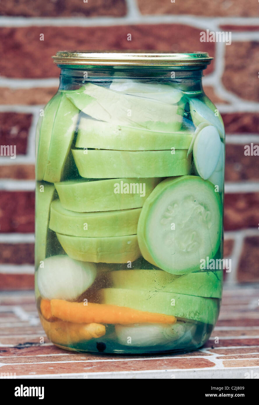 Marinated Vegetables in glass banks - Stock Image