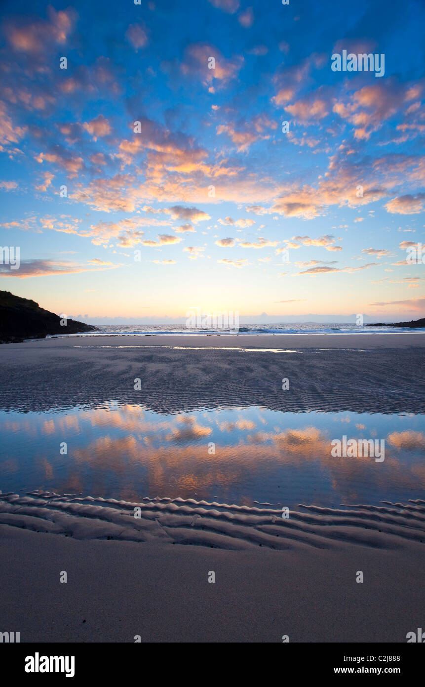 Evening beach reflections in False Bay, Connemara, County Galway, Ireland. - Stock Image