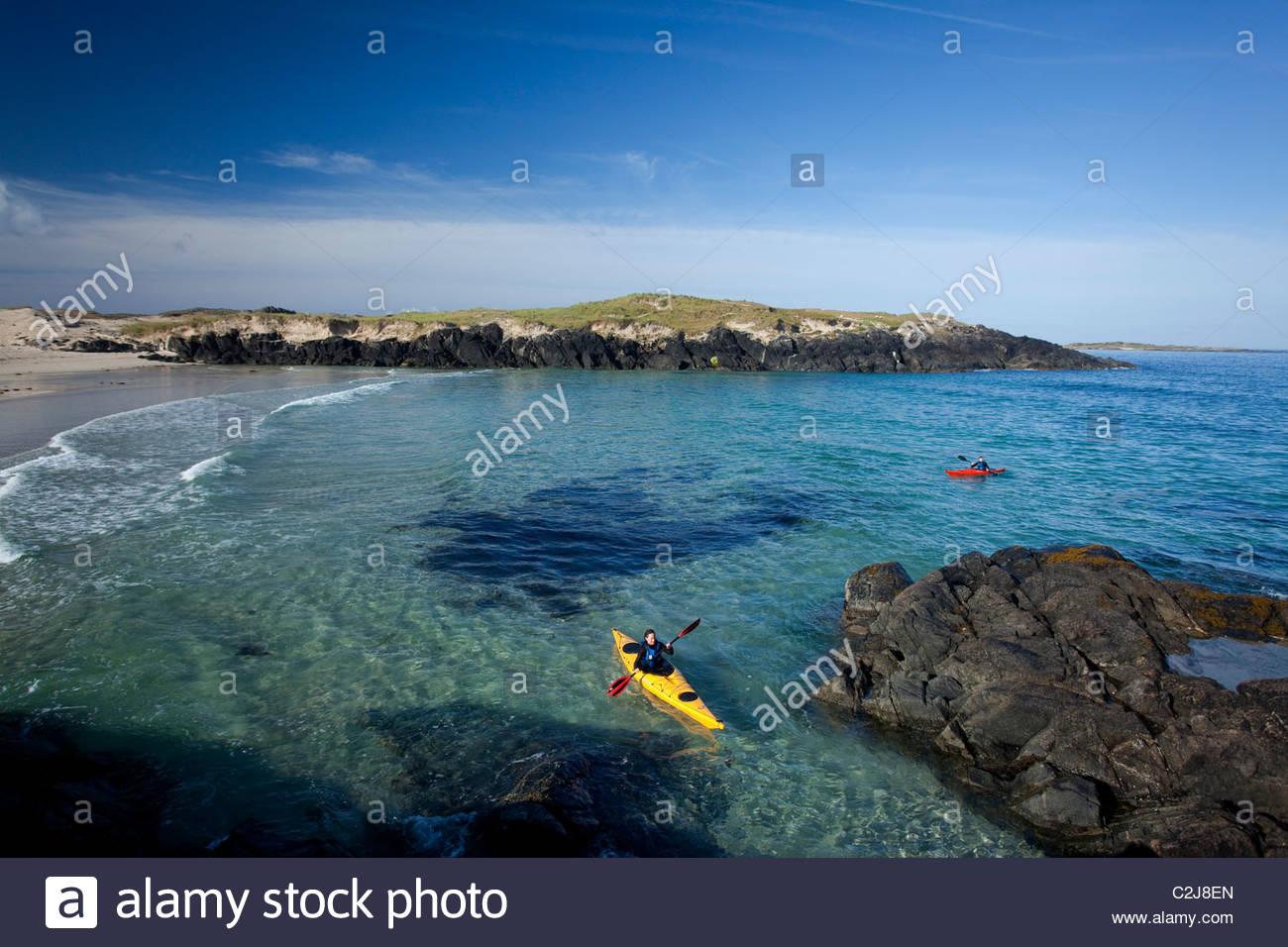 Sea kayaking in False Bay, Mannin Bay, Connemara, County Galway, Ireland. - Stock Image