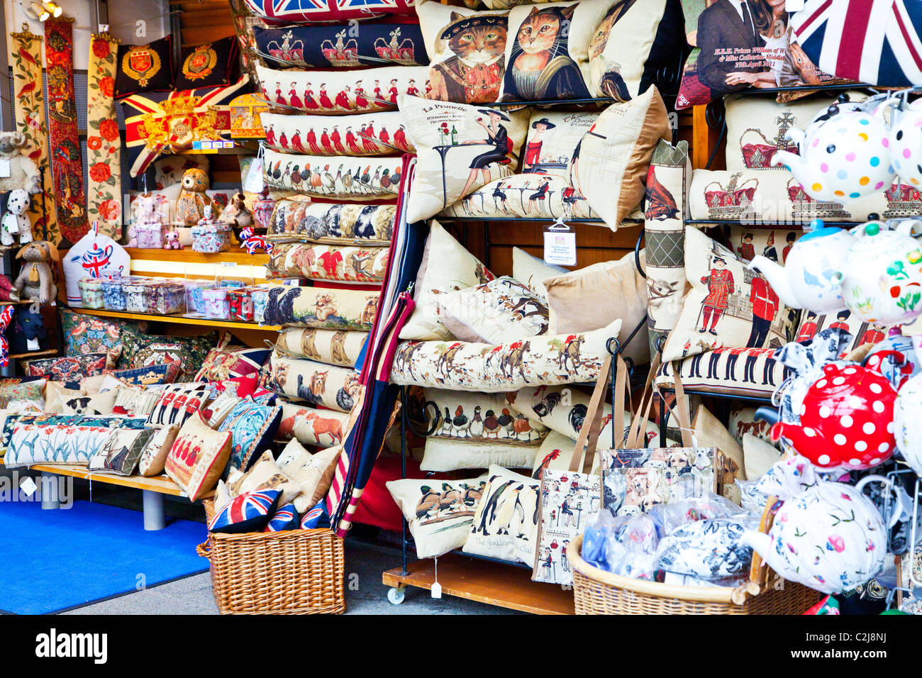 Display of souvenirs,memorabilia and gifts of England on an indoor market stall in Windsor, Berkshire, England, - Stock Image