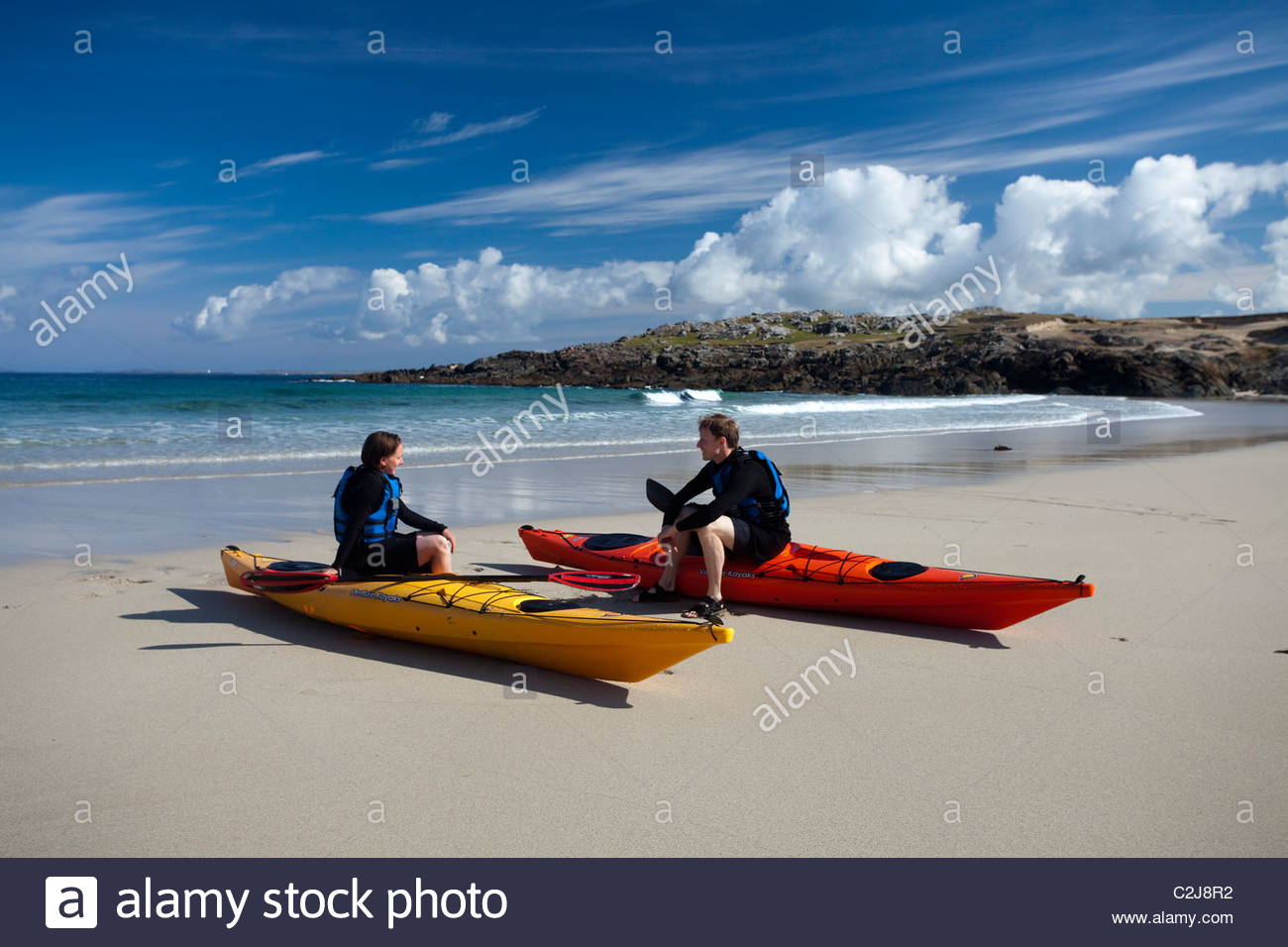 Sea kayakers resting in False Bay, Mannin Bay, Connemara, County Galway, Ireland. - Stock Image