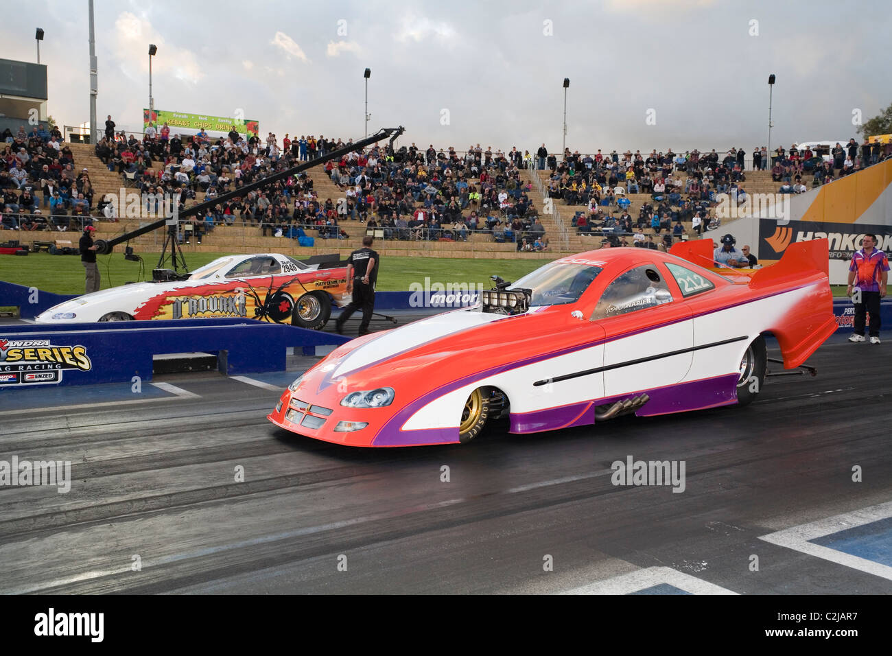 two drag racing cars line up ready to race at the track Stock Photo ...