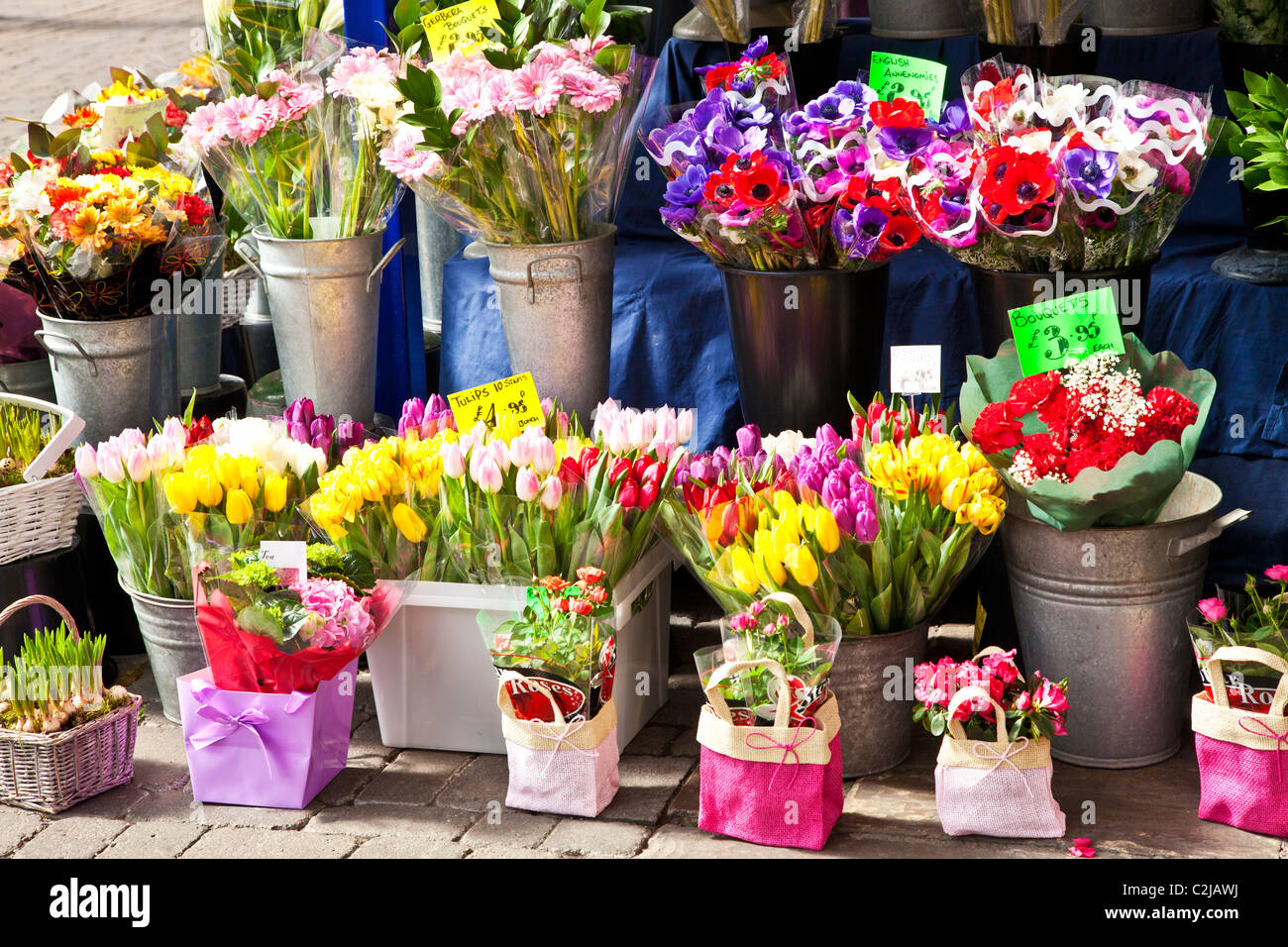 Floral display of cut bunches and bouquets of spring flowers outside ...