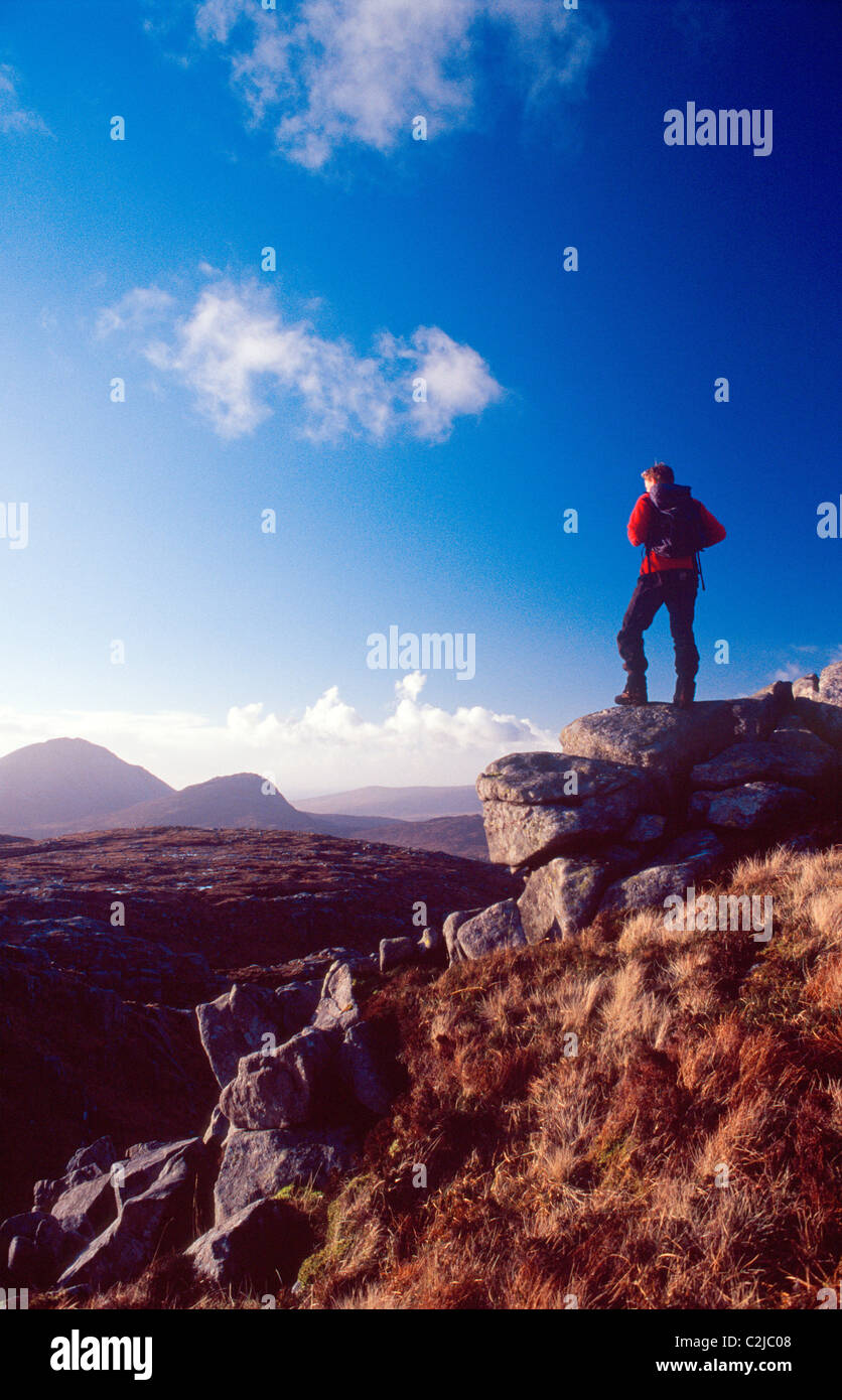 Walker looking towards Errigal Mountain from Dooish. Glenveagh National Park, Derryveagh Mountains, Co Donegal, - Stock Image