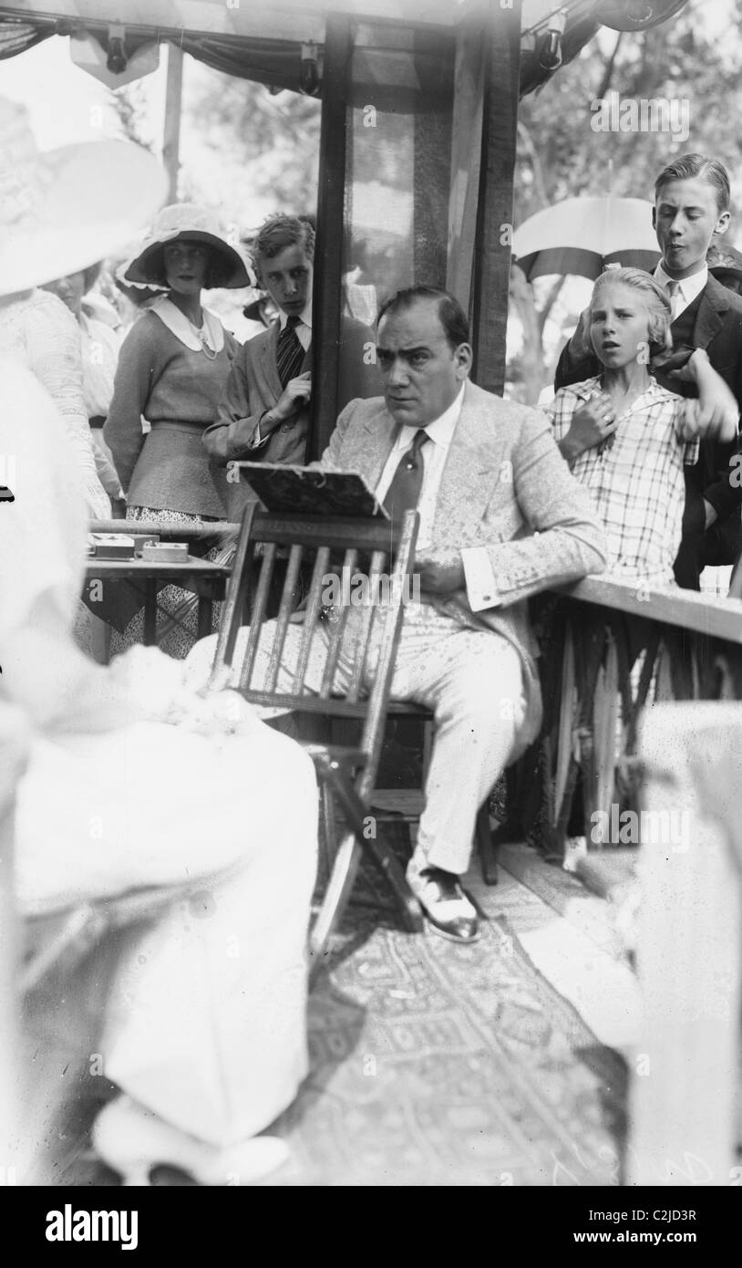 Enrico Caruso Leans back on chair holding a Board with Music - Stock Image