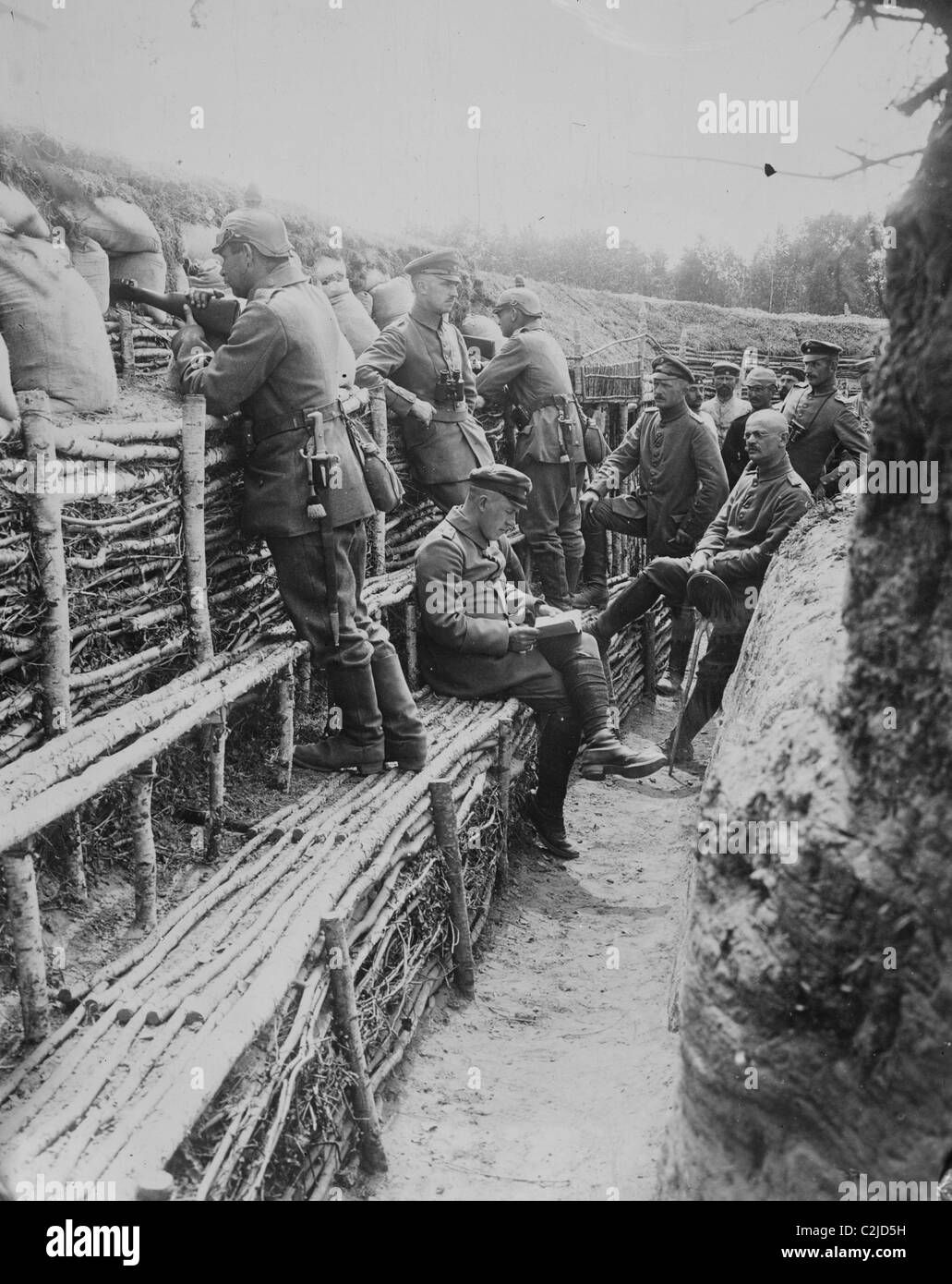 German Soldiers relax in their deep trenches which in the Stalemates of WWI have become a home. - Stock Image