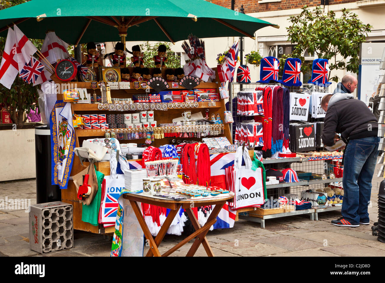 Display of souvenirs,memorabilia and gifts of England and London on a street stall in Windsor, Berkshire, England, - Stock Image