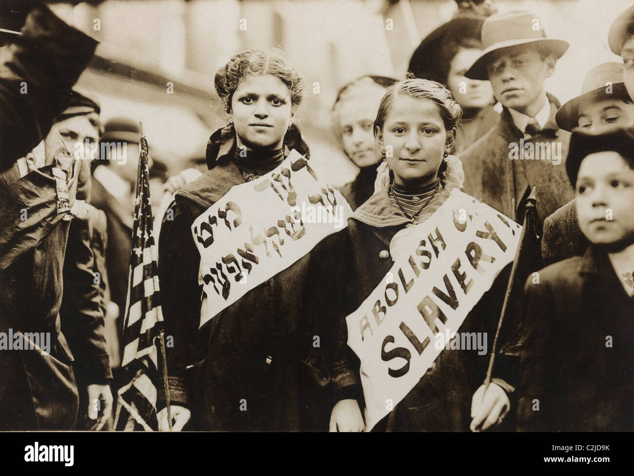 Young Girls Protest Child Labor in New York Rally and carry Yiddish Signs - Stock Image