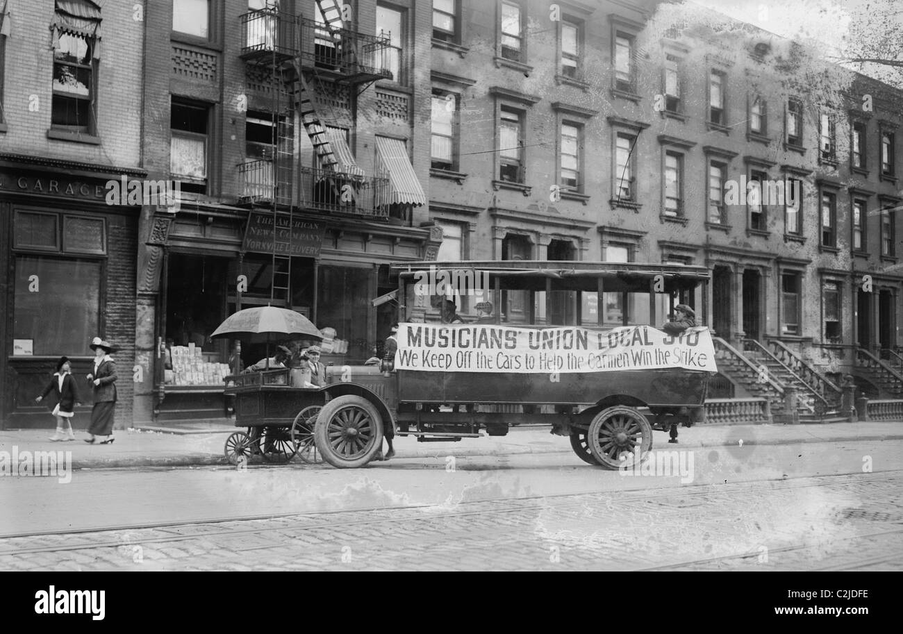Musicians Union Truck parked by Hot Dog Vendor Cart sports large banner supporting the Transit Strike - Stock Image