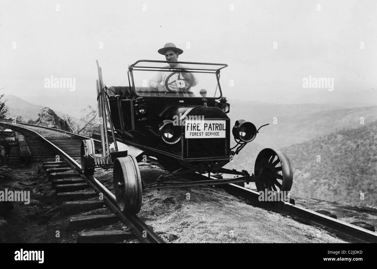 Fire Patrol Rides Steel wheeled car over Railroad Tracks - Stock Image