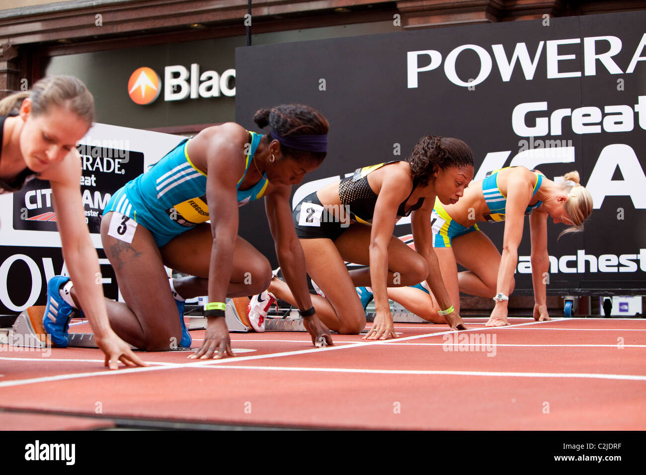 Allyson Felix, Debbie Ferguson and Emily Freeman on the blocks for the 200m at Manchester Great City Games 2010 - Stock Image