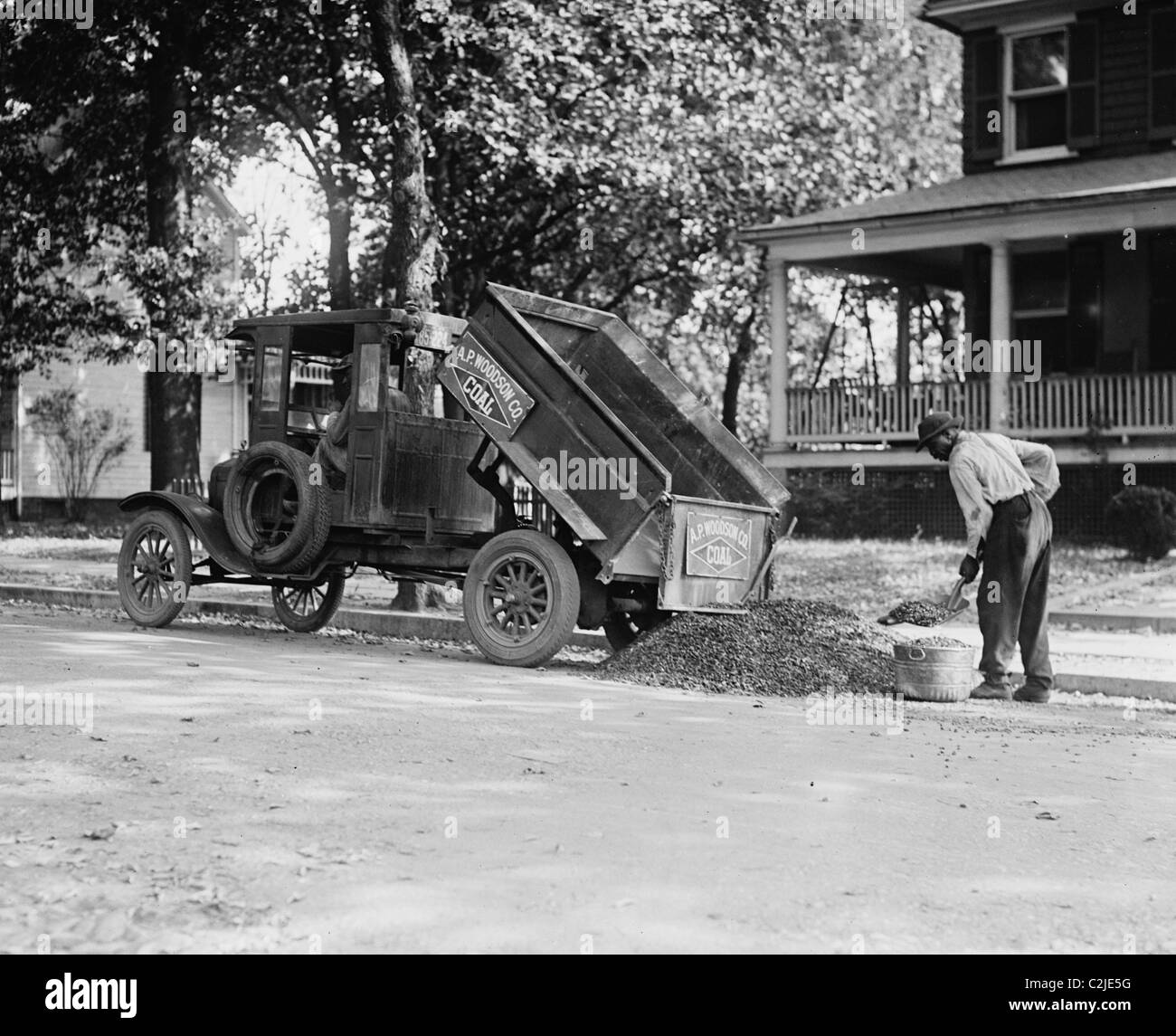 Ford Trucks Stock Photos Images Alamy 1961 Dump Truck Heating Coal Being Shoveled From A Image