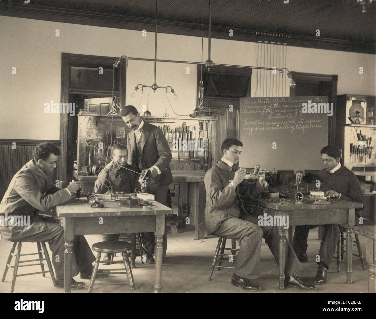 African American Students Study Telephone Assembly at the Hampton Institute - Stock Image