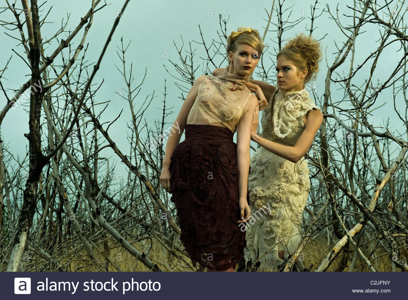 Girls are standing in a field and having disagreement - Stock Image