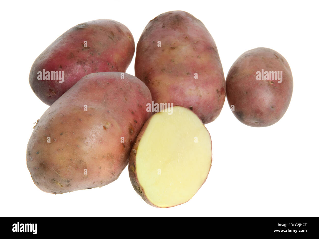 Five potatoes isolated on a white background - Stock Image