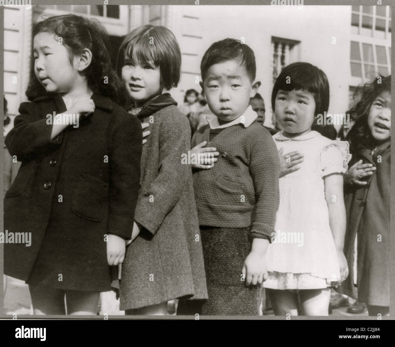Evacuated Japanese Children Pledge their allegiance to the US Stock Photo