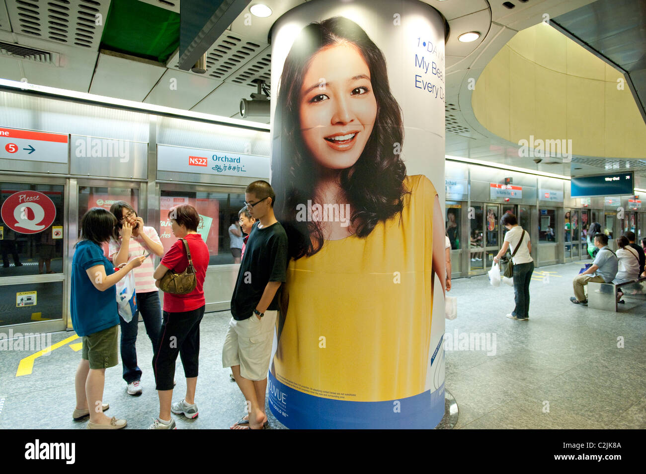 Striking advertising in Singapore's Mass Rapid Transit (MRT) metro system. Here at Orchard Station on the North Stock Photo