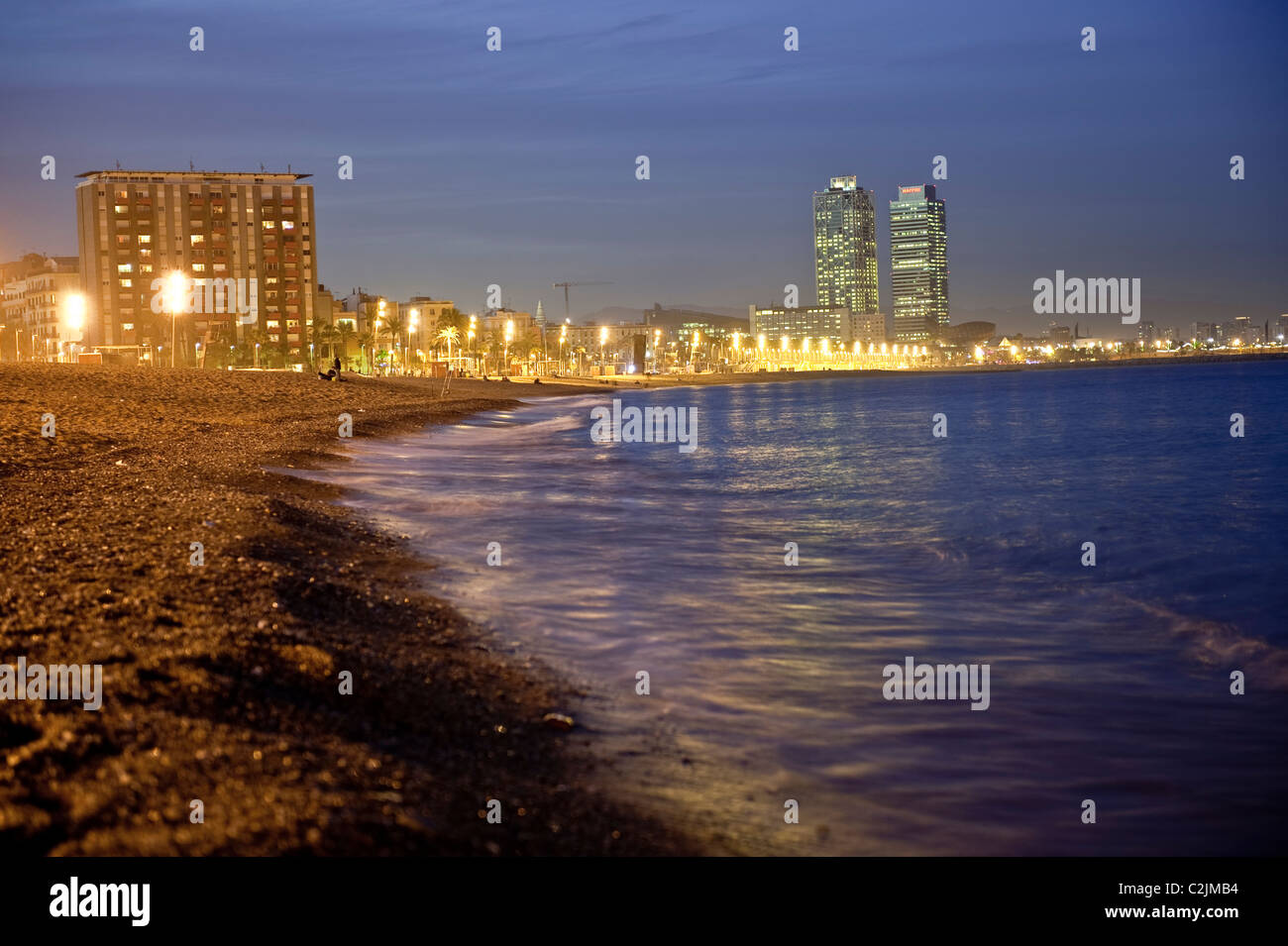 View of Barcelona's coast by night, Spain - Stock Image