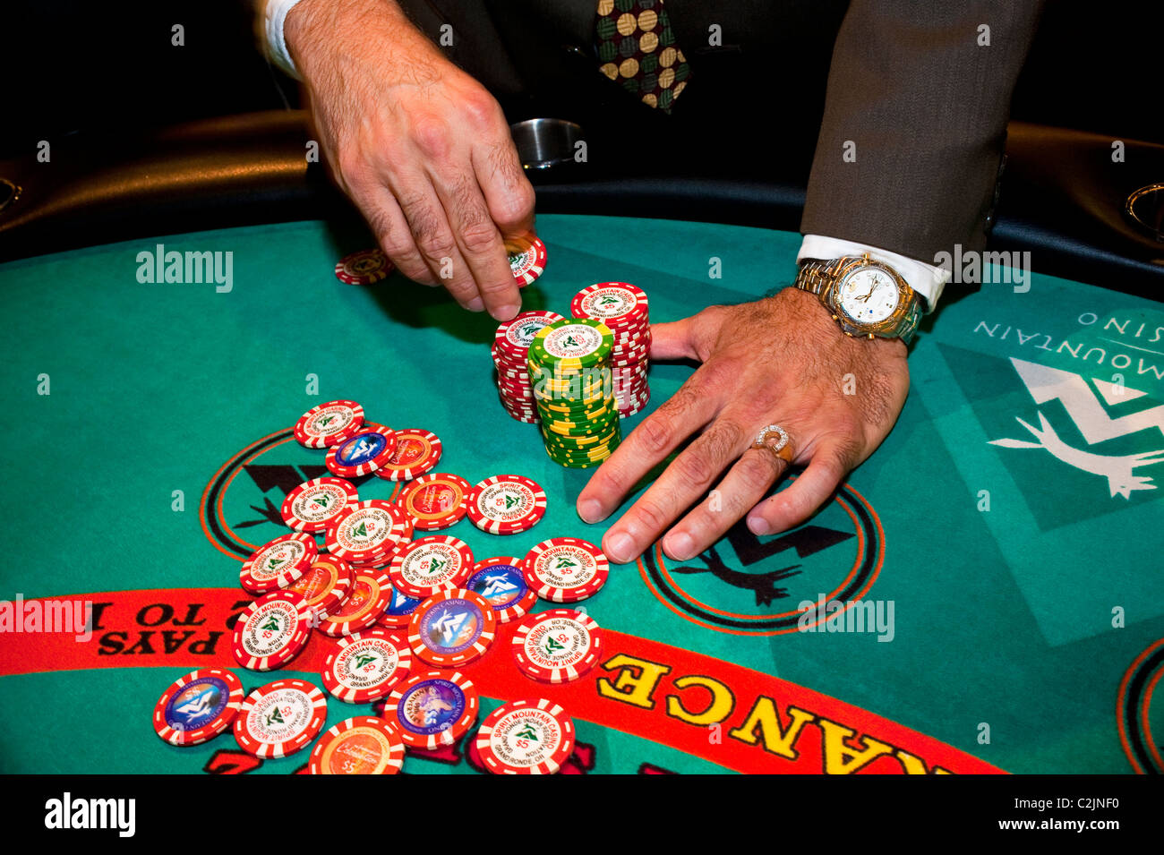 Blackjack table with player and chips at Spirit Mountain Casino, Oregon's largest casino, Grande Ronde, Oregon, - Stock Image