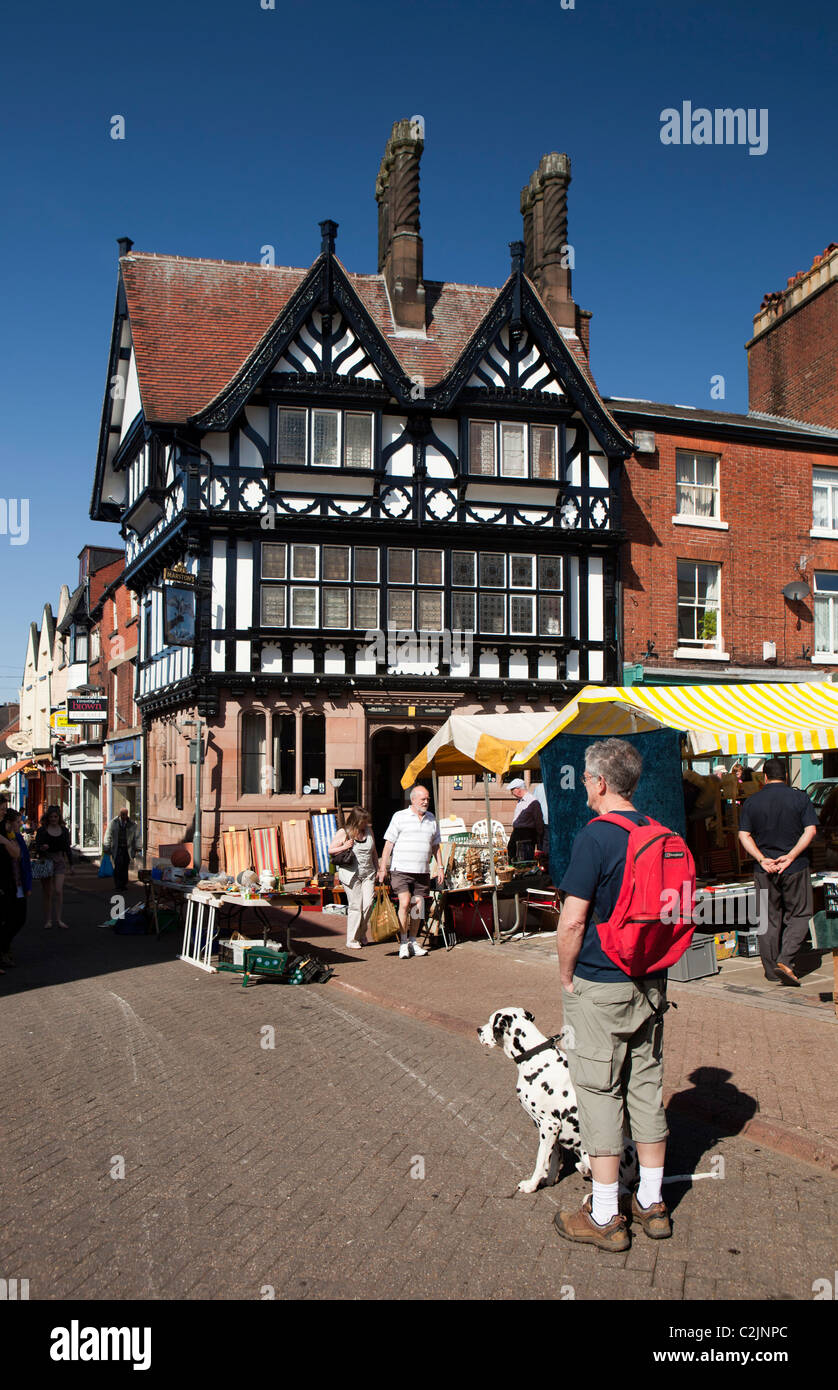 UK, England, Staffordshire, Leek, Market Place, man and dog at Saturday antiques and collectibles market - Stock Image