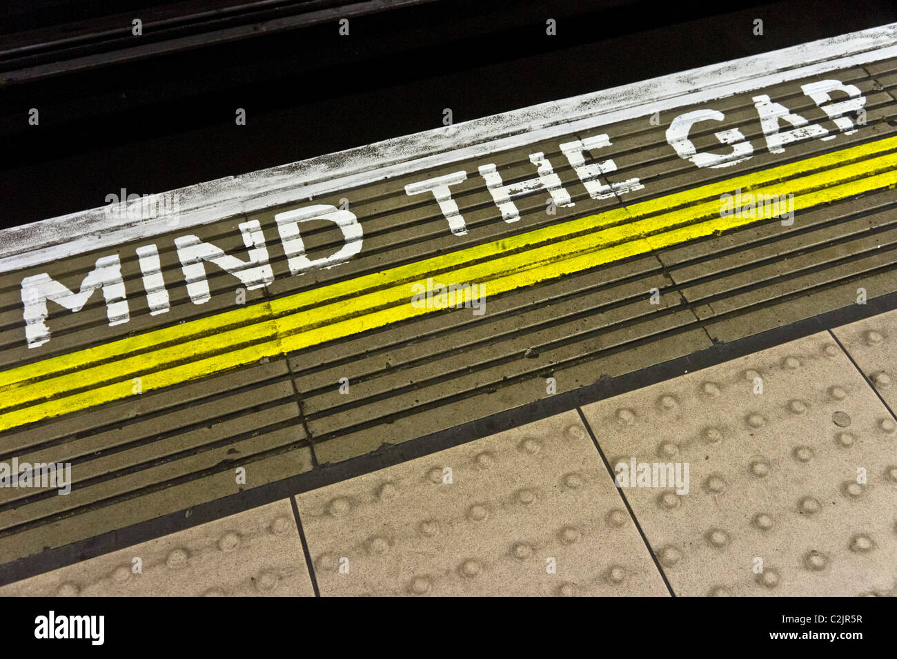 Mind the Gap warning on the edge of a London Underground station's platform, London, England - Stock Image