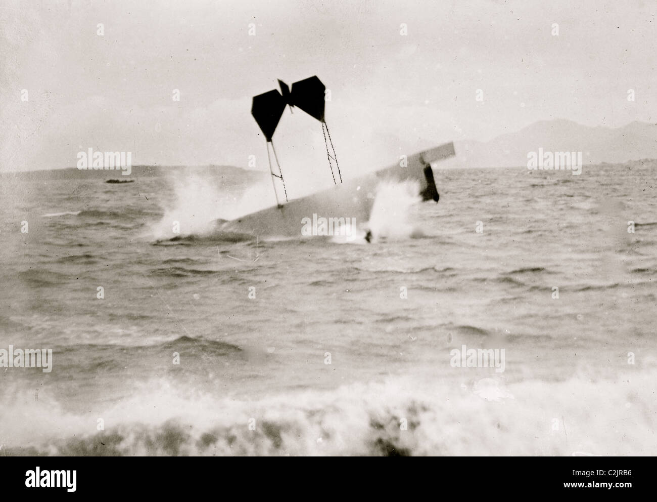 airplane of pilot and daredevil Hugh Armstrong Robinson (1881-1963) making a crash landing on water near Nice, France, - Stock Image