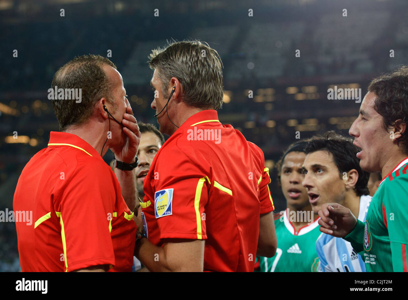 Referee Roberto Rosetti (r) and Assistant Stefano Ayroldi (l) confer after a controversial Argentina goal during - Stock Image