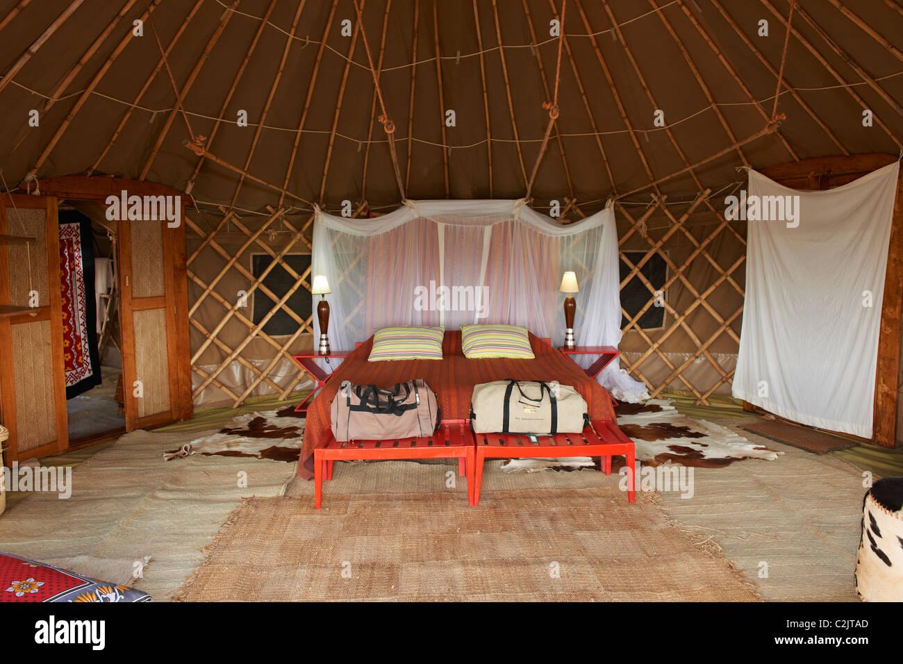 interior shot of  luxury sleeping room in tent of Nduara Loliondo Tended Safari Camp, Serengeti, Tanzania, Africa - Stock Image