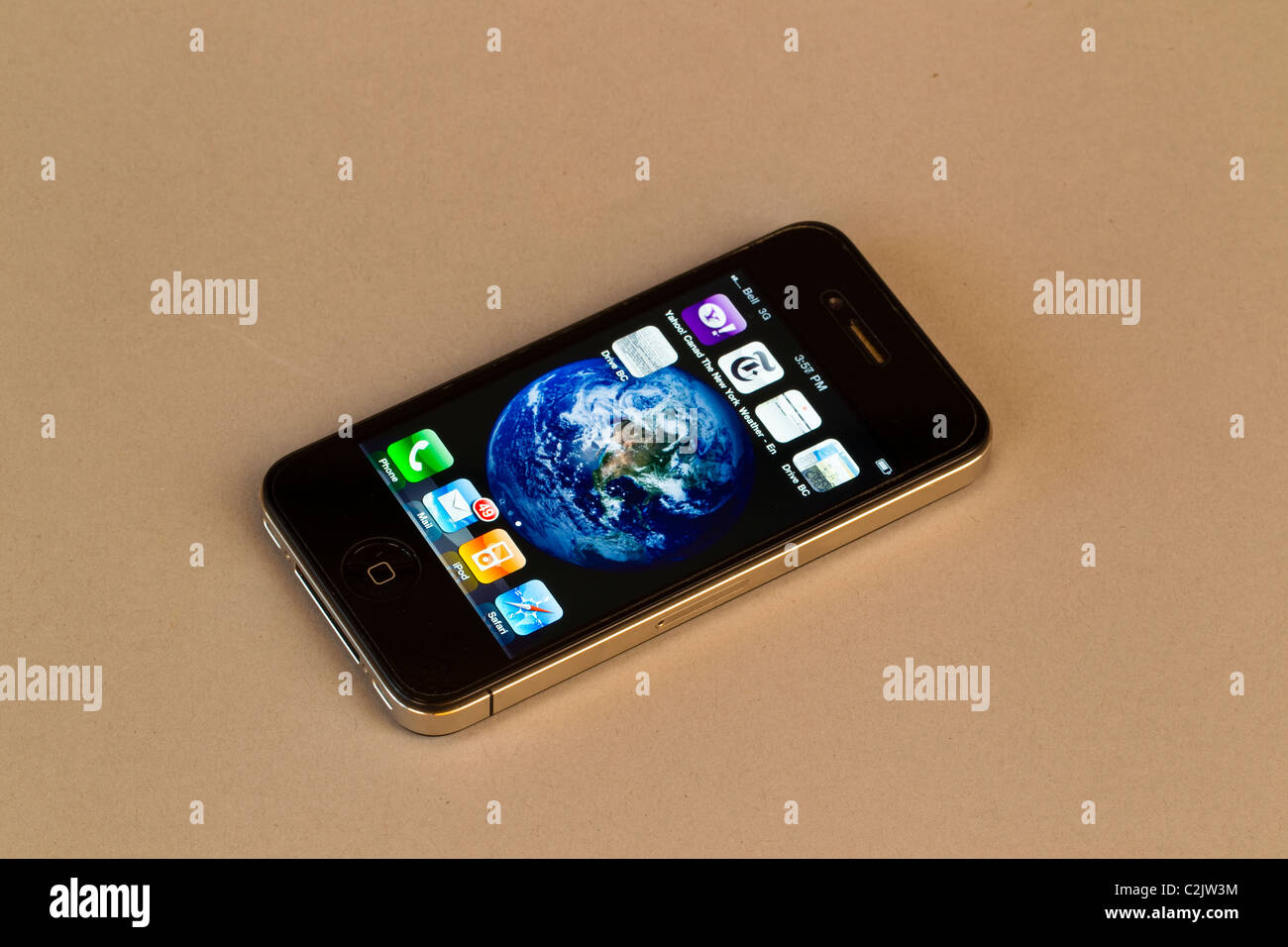 A cell phone shows an image of the Earth. - Stock Image