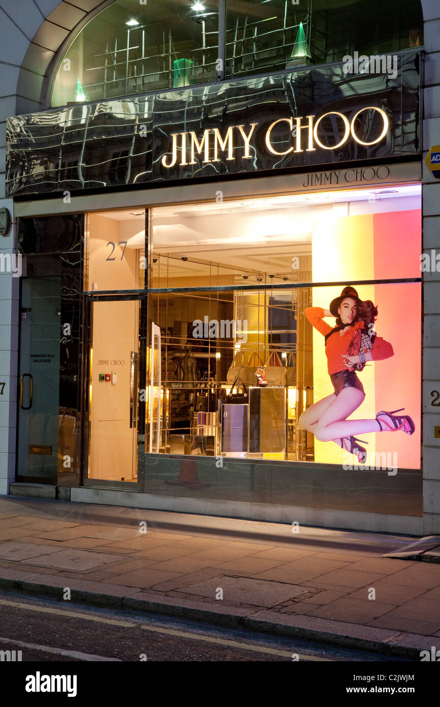 Jimmy Choo store in London in the evening - Stock Image