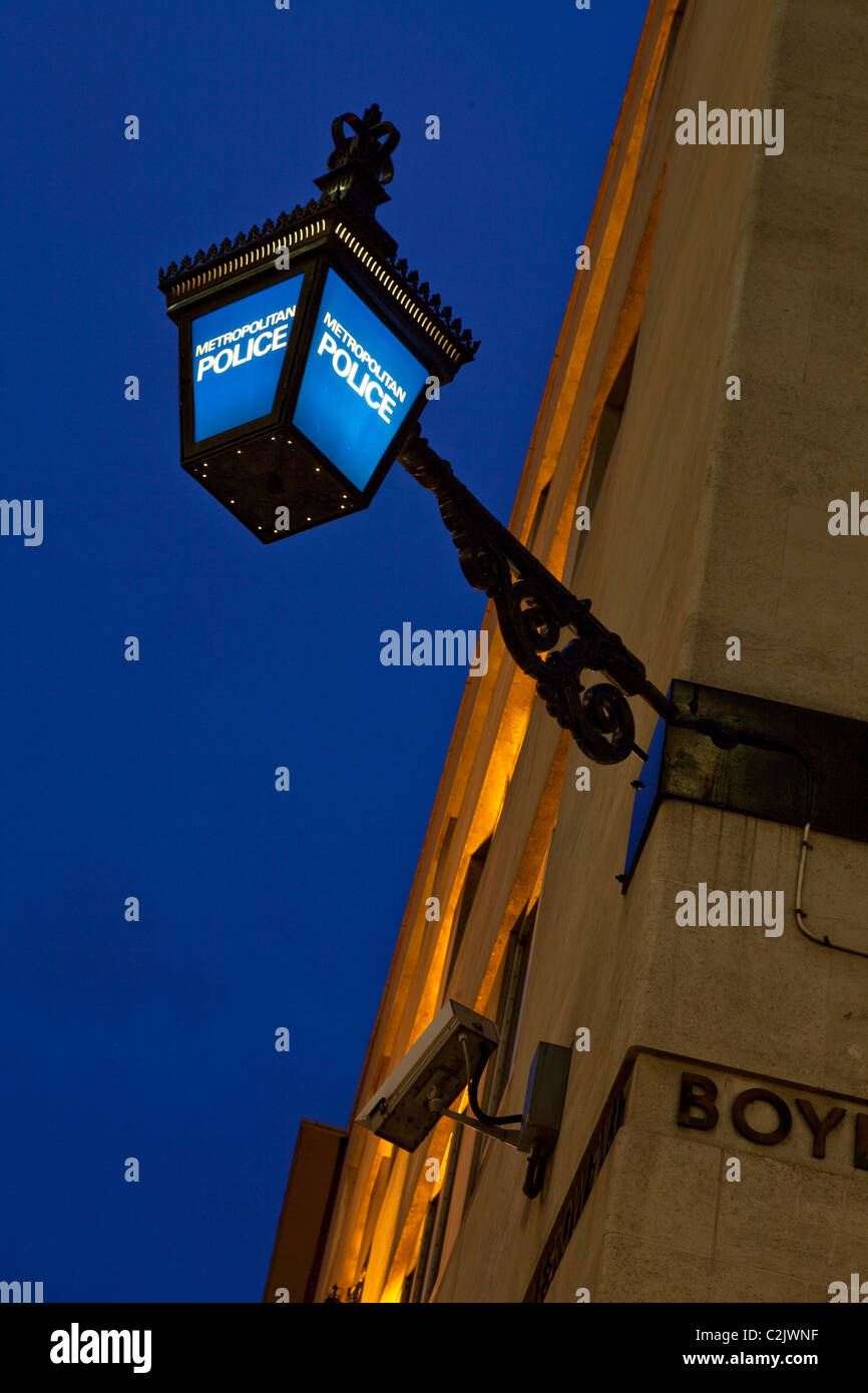 A traditional Police sign above the Saville Row Police Station in London's West End - Stock Image
