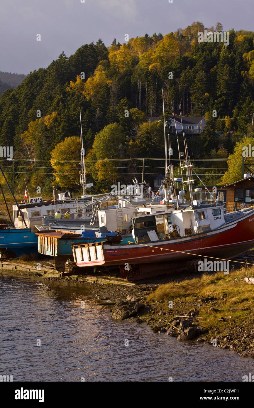 Fishing boats beached during low tide. Alma, New Brunswick, Canada - Stock Image