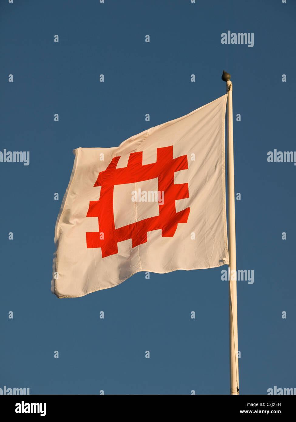 English Heritage flag flying above Calshot Castle Hampshire England UK - Stock Image