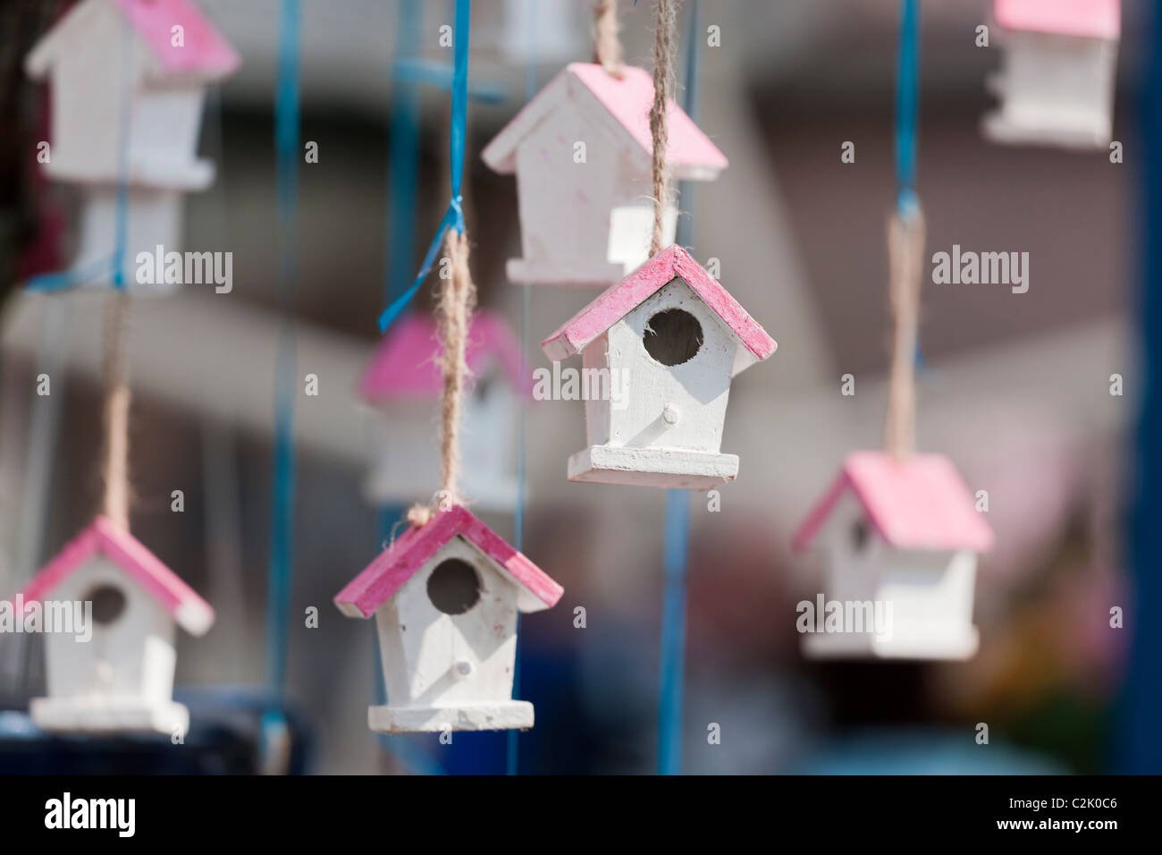 Small birdhouse used as decoration. Little bird houses strings attached hanging. Garden decorations at the Keukenhof, - Stock Image