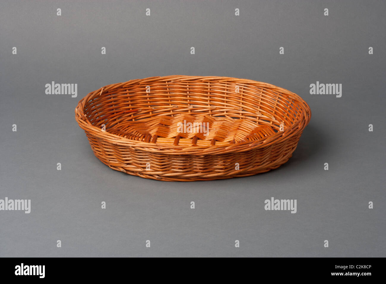 Bread basket on a grey background - Stock Image