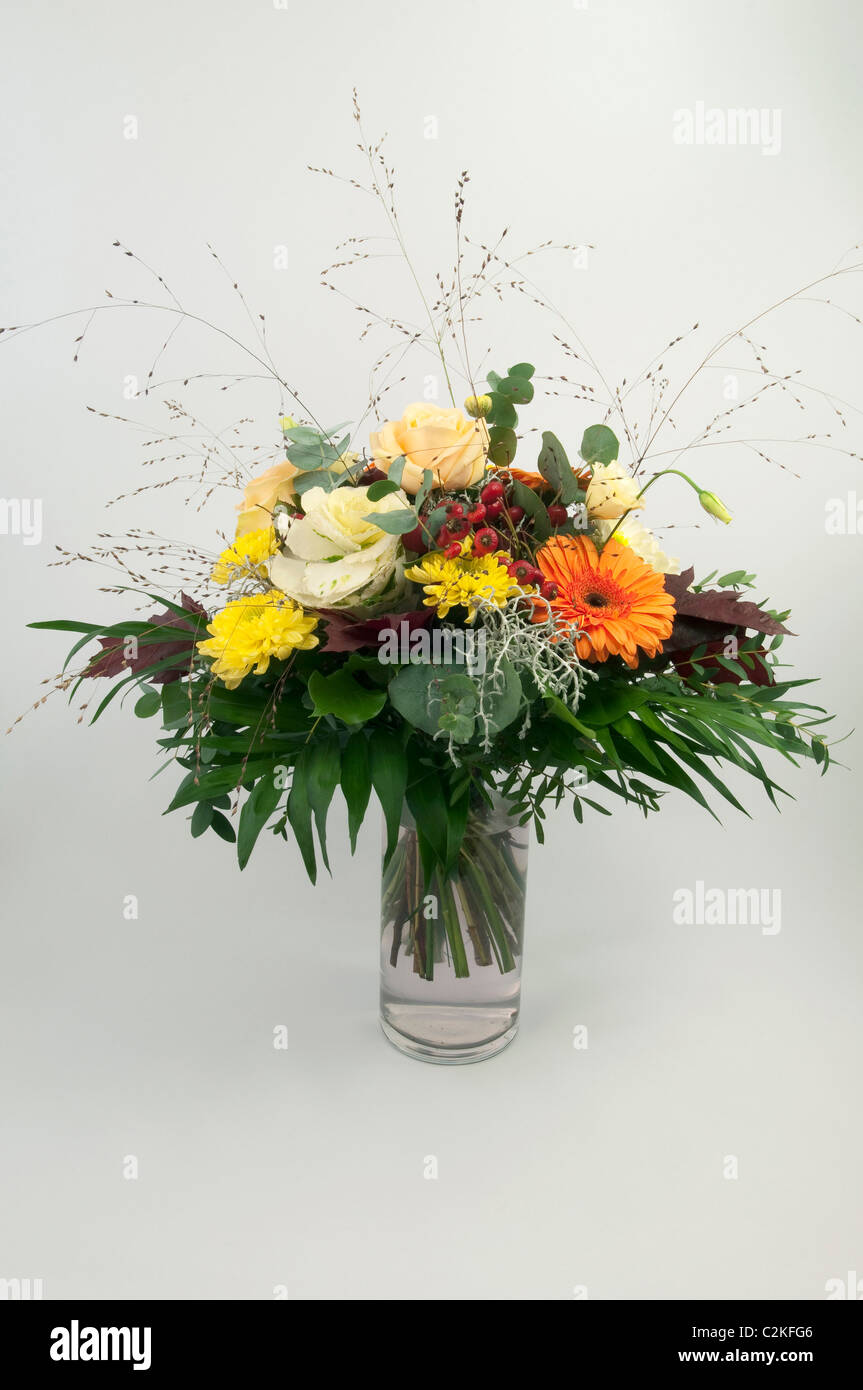 Bouquet in a vase, studio picture against a white background. - Stock Image