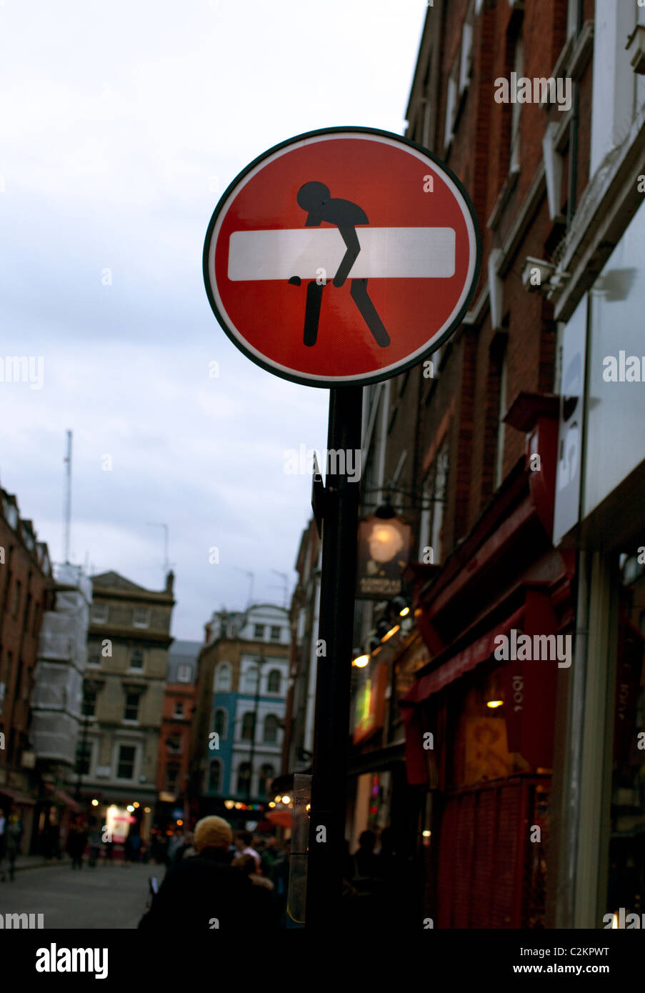 Graffitised No Entry sign in Central London street - Stock Image