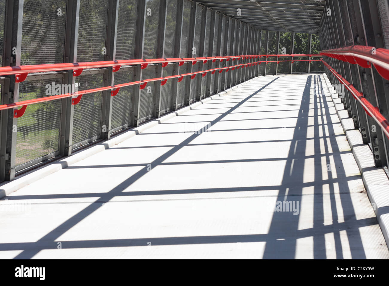 Walking Bridge enclosed for Safety - Stock Image
