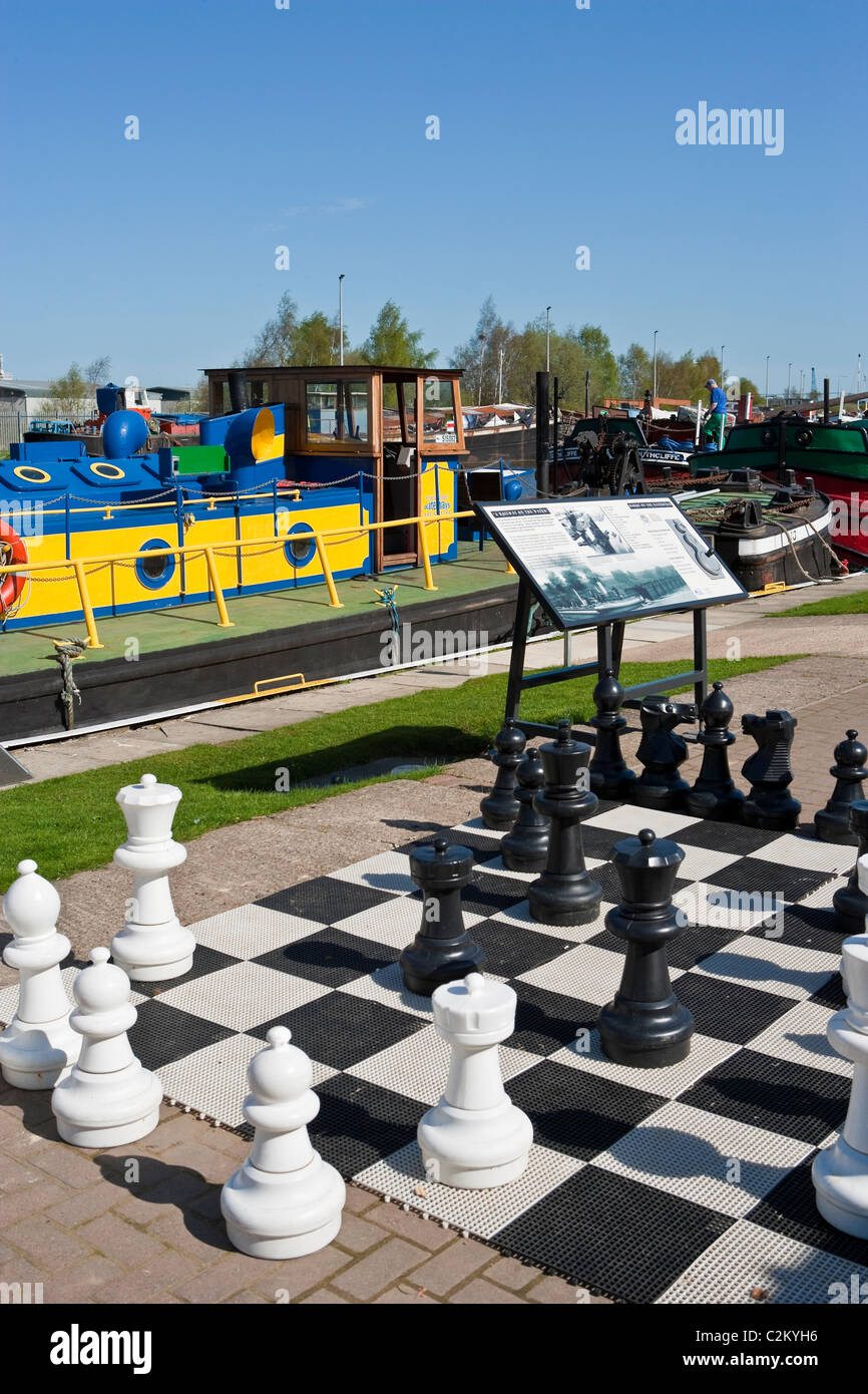 Yorkshire Waterways Museum Dutch Riverside, Goole, West Yorkshire, England, U.K. showing pavement chessboard in - Stock Image