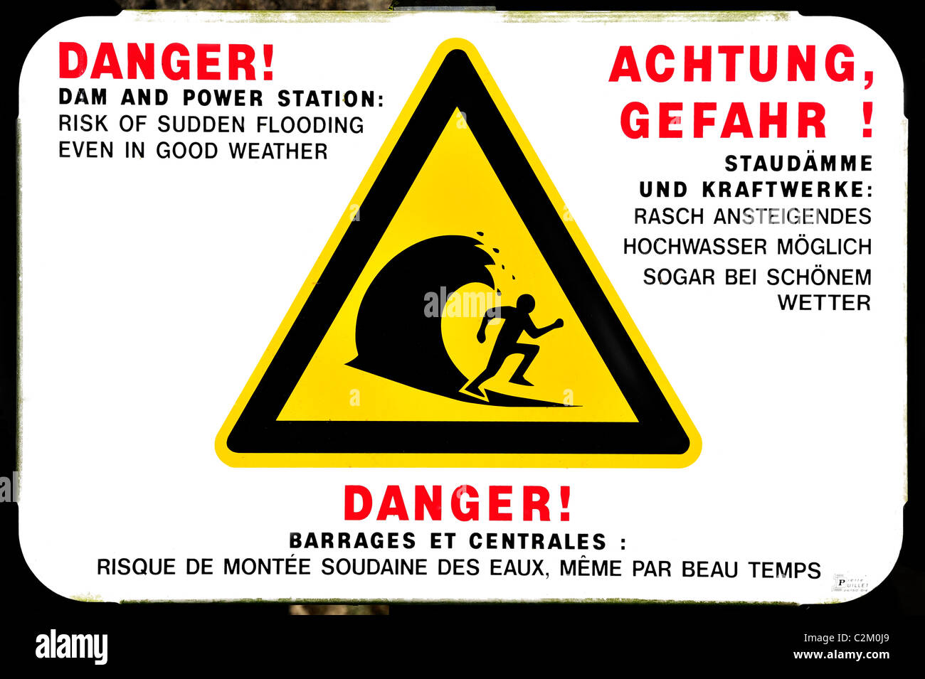 Warning sign for sudden flooding of river by dam from power station, France - Stock Image