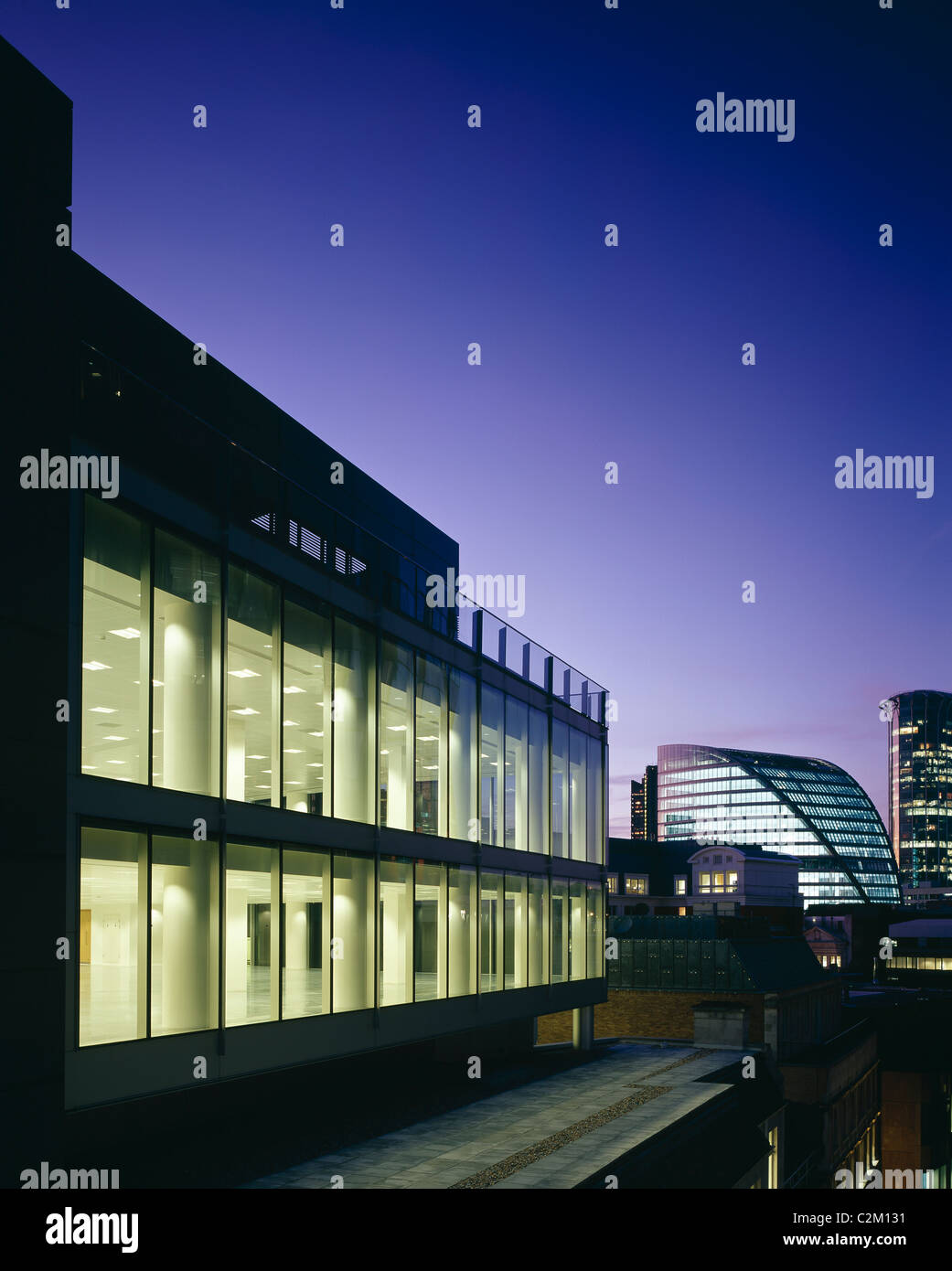41 Lothbury, London. Offices integrating existing listed interior. Exterior at dusk. - Stock Image
