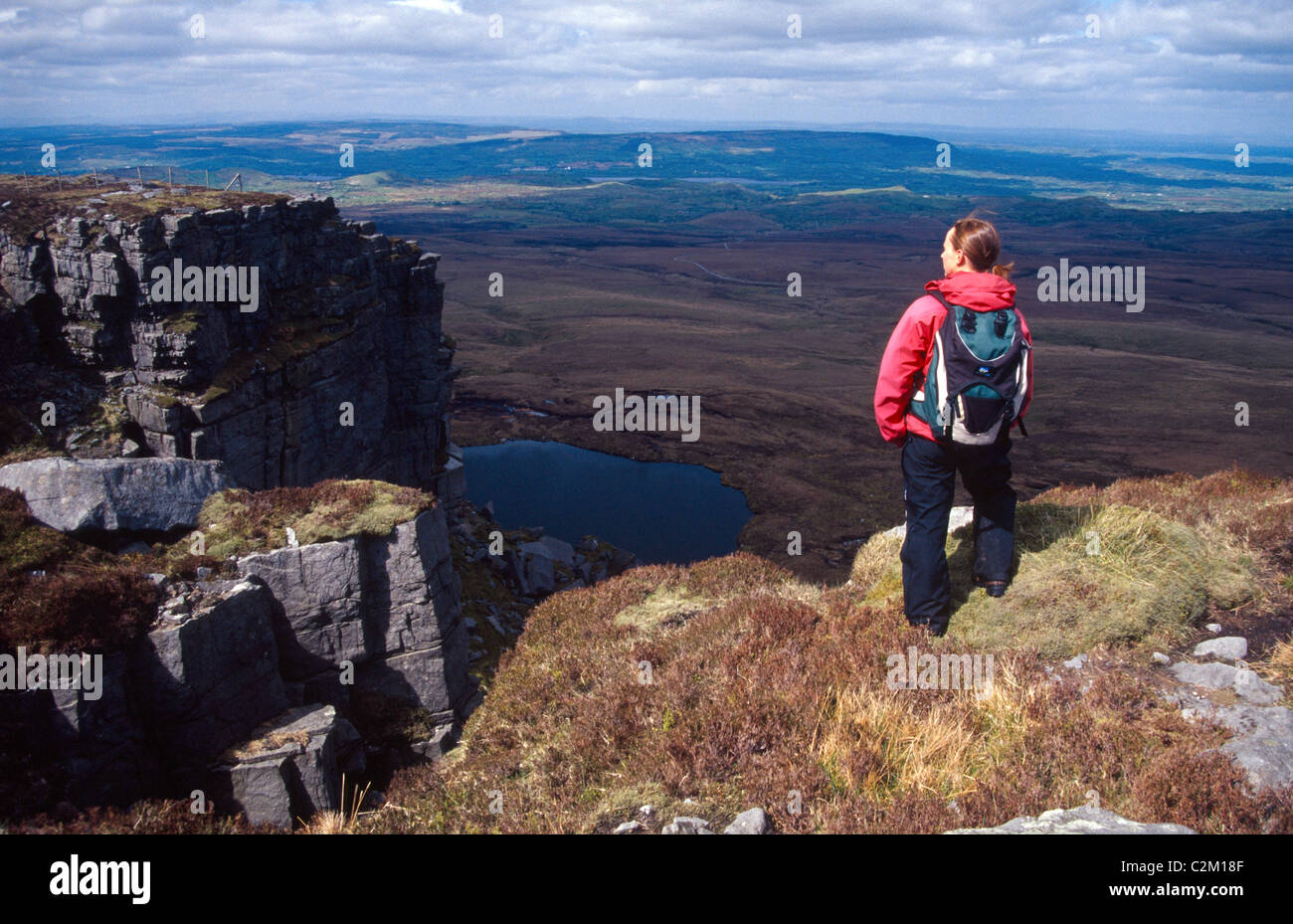 Walker on the summit of Cuilcagh Mountain, County Fermanagh, Northern Ireland. - Stock Image