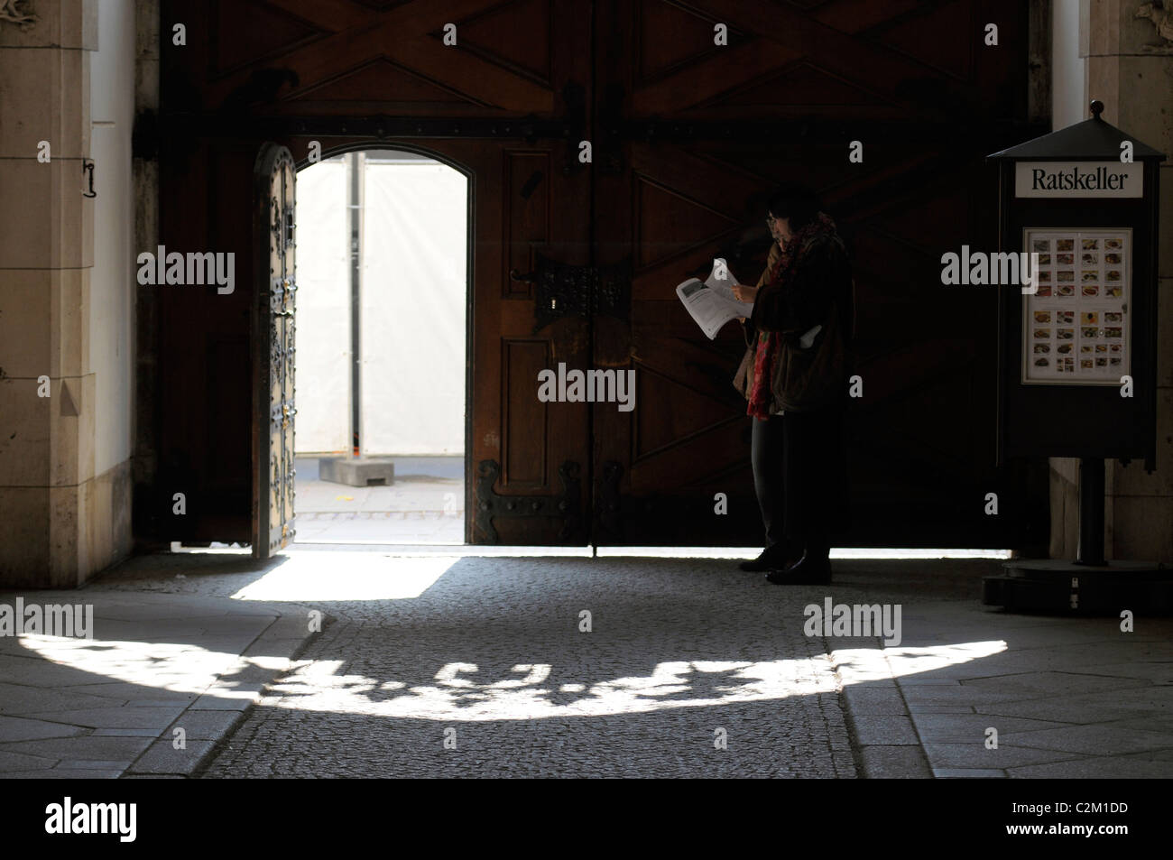 Door to town hall with shadow pattern, Munich, Germany - Stock Image