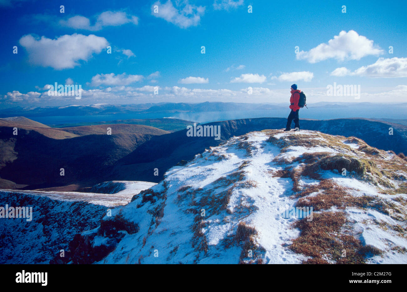 Winter walker on the summit of Gearhane, Brandon massif, Dingle Peninsula, County Kerry, Ireland. - Stock Image