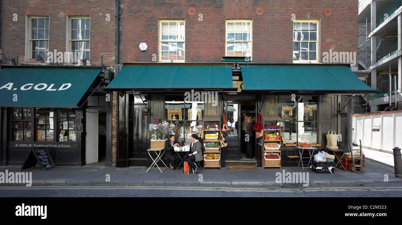 Shop fronts, Spitalfields, London. - Stock Image
